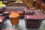 Sale 8335 - Lot 1036 - Gascoigne Red Buttoned Leather Chesterfield 3 Seater Lounge & Tub Armchair (have adhesive labels)