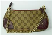 Sale 8460F - Lot 15 - A small Gucci shoulder bag with beige and ebony GG Supreme canvas and gilt chain strap, W 24cm, worn