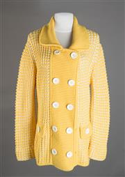 Sale 8493A - Lot 18 - An Escada Sports yellow and white woolen knit cardigan, size XL