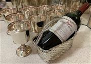 Sale 8510A - Lot 14 - A Christofle silver plate, woven bottle carrier together with a bottle of Penfolds Rawson Retreat Cabernet Sauvignon Shiraz 94 and...