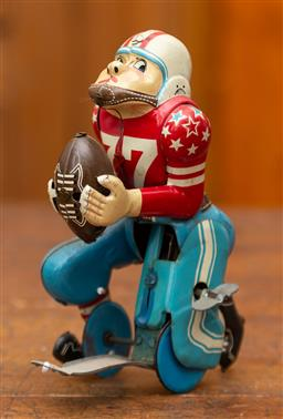Sale 9160H - Lot 36 - A Japanese made tin plate prop american football player with wind up mechanism, Height 15cm, marked Line Mar toys,  ex fox studio...