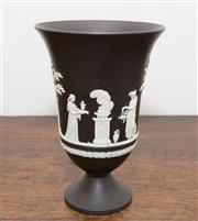 Sale 8338A - Lot 63 - A Wedgwood black Jasperware footed vase with classical scenes, H 19cm