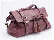 Sale 8640F - Lot 3 - A Mulberry saddle bag in burgundy leather with tasselled bow to front and stud detailing, H 24 x W 34cm.