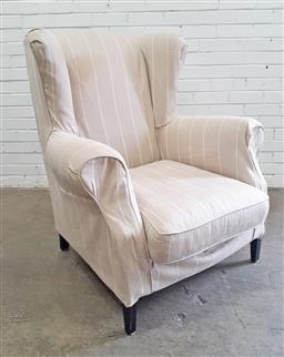 Sale 9102 - Lot 1039 - Cream tone fabric covered wingback armchair (h:110 x w:83 x d:79cm)