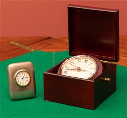 Sale 9260M - Lot 24 - A Nautical reproduction timber cased quartz clock together with another in metal casing (H 7cm)