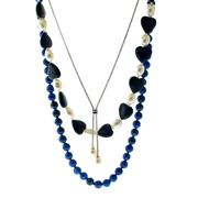 Sale 8087B - Lot 341 - THREE ASSORTED NECKLACES; a strand of lapis beads, a lapis and cultured freshwater pearl strand and a silver lariat suspending 2 fre...