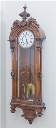 Sale 8430 - Lot 61 - A C19th Austrian walnut wall clock with enamelled dial and single train movement