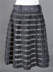 Sale 8493A - Lot 22 - A Phillip Lim cotton mix pleated skirt in black and transparent horizontal stripes with silk lining and belt, size 4