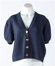 Sale 9003F - Lot 92 - A St John short sleeeved cardigan with gold buttons in navy blue, size M