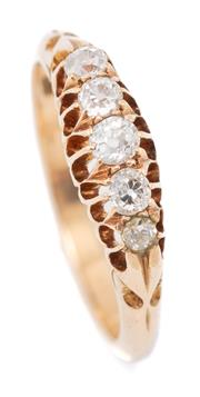 Sale 9066 - Lot 388 - A VINTAGE 14CT GOLD DIAMOND RING; belcher set with 4 Old European cut and an early single cut diamond totalling approx. 0.30ct, size...