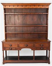 Sale 8599A - Lot 16 - A Georgian oak Welsh dresser fitted with three shelves and blacksmiths hooks, a frieze with five bead drawers and original rosewood...