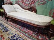 Sale 8792 - Lot 1071 - A late C19th cedar framed Victorian chaise lounge, with a serpentine pierced back upholstered in a distressed cream fabric and raise...