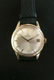 Sale 9080J - Lot 125 - Vintage Omega 563 date wristwatch in gold plated case, automatic movement running fine. 34 mm