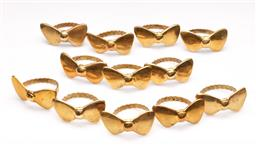 Sale 9119 - Lot 192 - A set of twelve brass bow tie form napkin ring holders