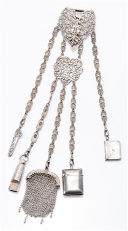 Sale 9180E - Lot 131 - An EPNS chained Victorian five silver charmed chatelaine with Green Man motif, silver charms include vesta, coin purse, whistle, env...