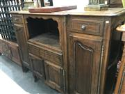 Sale 8868 - Lot 1088 - Louis XV Style Oak Breakfront Sideboard, with an open shelf, drawer & two small doors, flanked by two drawers and tall doors (2 x Ke...