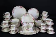 Sale 8935 - Lot 18 - An Early c.20th Royal Doulton English Rose (D6071) Dinner Service for 12
