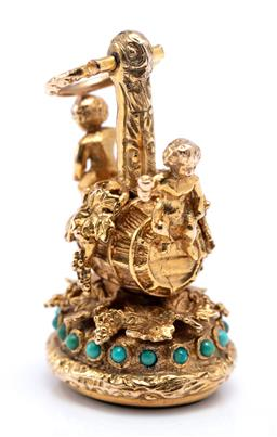 Sale 9194 - Lot 364 - A 9CT GOLD STONE SET BACCHANALIAN FOB SEAL; featuring 2 cherubs on a barrel applied with grape and vine leaves on a similar ground s...