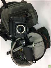 Sale 8648A - Lot 4 - Canon EOS 1N together with Canon EF Image Stabilizer 24-105mm/F4 USM L-Series Lens in LowePro Camera Bags with Accessories incl Ligh...