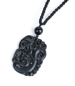 Sale 9091F - Lot 252 - A CARVED CHINESE BLACK STONE DRAGON PENDANT; L5.5cm