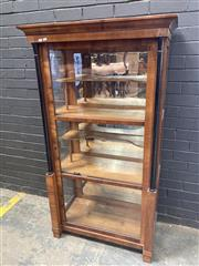 Sale 9068 - Lot 1032 - Biedermeier Walnut Display Cabinet, with glass panel door and ebonised columns on high plinths, enclosing three shelves & another tw...