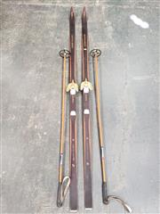 Sale 9076 - Lot 1018 - Pair of vintage Norwegian timber snow skis and stocks (l:204cm)