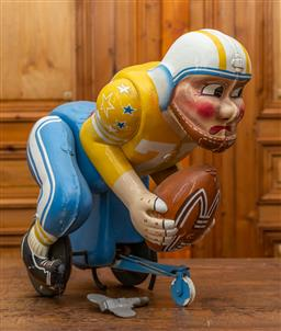 Sale 9160H - Lot 37 - A prop toy american football player with wind up mechanism, with key, Height 50cm  ex fox studio toy sale of the movie TOYS