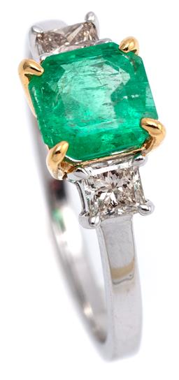 Sale 9164J - Lot 410 - AN 18CT WHITE GOLD EMERALD AND DIAMOND RING; claw set with a square emerald cut emerald of approx. 1.31ct, adjacent to a princess cu...