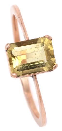 Sale 9132 - Lot 306 - A GOLD SOLITIARE HELIODOR RING; hand made piece in 12ct with an emerald cut yellow beryl of approx. 1.33ct, size P1/2, width 8mm, 2....