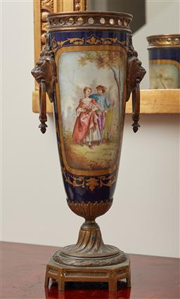 Sale 9099 - Lot 261 - A Sevres style continental vase with brass mounts and twin handled lion masks to side, Height 36cm