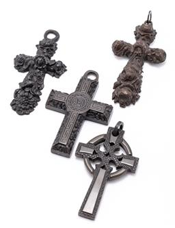 Sale 9180E - Lot 116 - Group of four vulcanite and other cross form pendants, average length 8.5cm