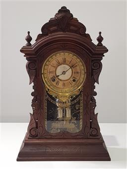 Sale 9215 - Lot 1075 - Late 19th Century Ansonia Carved Walnut Mantle Clock, with two-train movement, paper & brass dial & stencilled glass panel door - un...