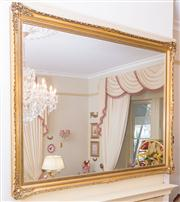 Sale 8430 - Lot 52 - A large gilt framed rectangular mirror with articulated corners. 147 x 194cm.