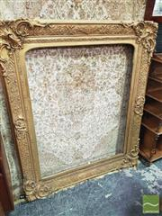 Sale 8416 - Lot 1069 - Large & Ornate Victorian Gilt Gesso Picture Frame by Arthur Whitcombe, with applied decoration & corner scrolls, with paper label to...