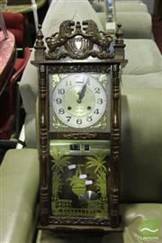 Sale 8499 - Lot 1091 - Timber Wall Clock