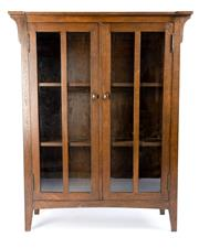 Sale 8599A - Lot 37 - A solid oak Arts & Crafts double glazed door bookcase fitted with interior shelving, H 169 x W 130 x D 47cm.