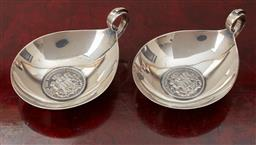 Sale 9099 - Lot 246 - A pair of silver German coin dishes. with three Mark piece inserts. 11cm length