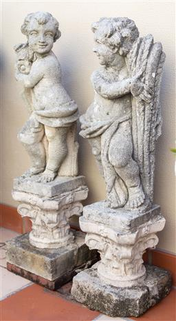 Sale 9165H - Lot 19 - A pair of weathered concrete cherubs on capital bases, Height 92cm