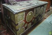 Sale 8317 - Lot 1010 - Antique Indo-Portuguese Fruitwood & Brass Mounted Trunk with a heavily embellished lift-lid