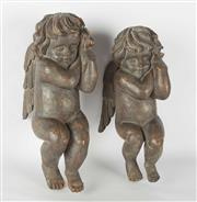 Sale 8599A - Lot 99 - A pair of antique timber carved cherubs, each approx 31cm long, Auctioneers note - whilst the wings are intact and contacted, there...