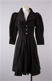 Sale 8740F - Lot 114 - A Lisa Ho black dress with exaggerated collar and buttons, mutton sleeves and a pleated skirt, size AUS 6