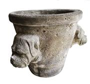 Sale 8888H - Lot 1 - A cast stone garden pot decorated with 3 bulldog heads 25 T x 29 cm W