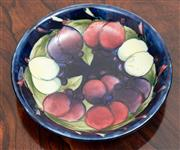 Sale 9070H - Lot 80 - A Moorcroft bowl decorated with Plums stamped and signed to base, diameter 18cm