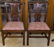 Sale 7981B - Lot 79 - A pair of George third mahogany side chairs with knurled top rails, open back splats. The trap seats upholstered in traditional broc...