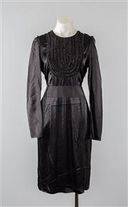 Sale 8740F - Lot 116 - A By Malene Birger black silk dress with a ruffled bib and exaggerated buttons to back, approx size 8/10