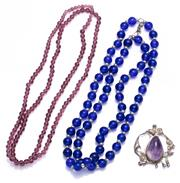 Sale 9010H - Lot 62 - Two strings of glass beads with a retro sterling silver and Amethyst pendant by Rewa Newman
