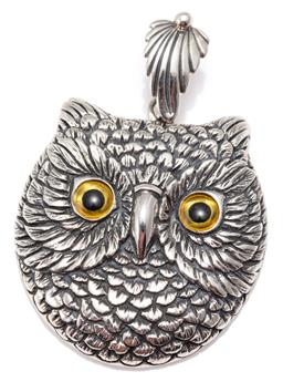 Sale 9156J - Lot 370 - A SILVER OWL PENDANT; 30 x 31mm owl with yellow and black glass eyes on a feather bale, length 44mm, wt. 11.72g.