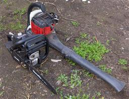 Sale 9191W - Lot 758 - A Homelite petrol blower together with a chainsaw