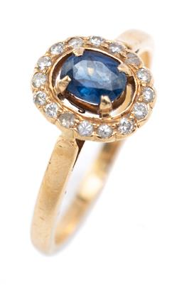 Sale 9194 - Lot 519 - AN 18CT GOLD SAPPHIRE AND DIAMOND CLUSTER RING; oval top centring an oval cut sapphire to surround set with 16 round brilliant cut d...