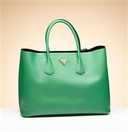 Sale 9253J - Lot 399 - A PRADA GREEN SAFFIANO LEATHER TOTE BAG; with top rolled handles, gold tone Prada logo and feet, opening to black leather interior,...